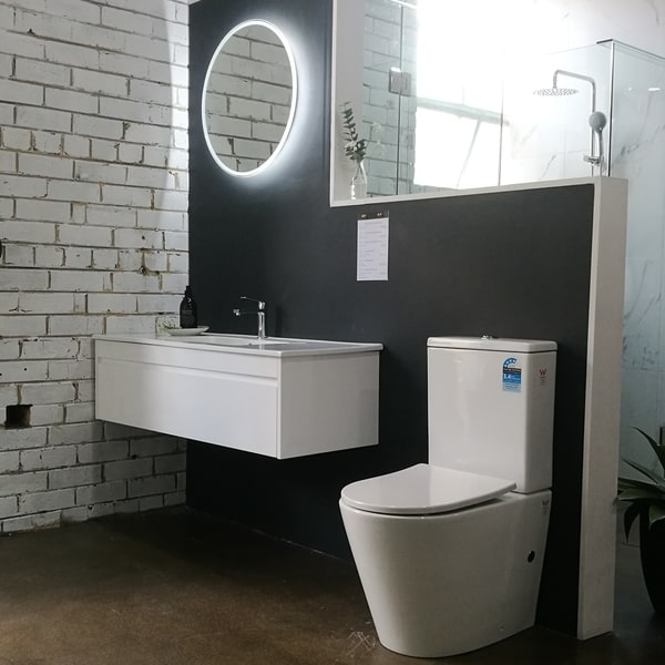Bathroom Sphere LED mirror in showroom with wall hung vanity and toilet